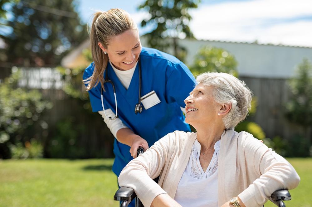 bigstock-Nurse-taking-care-of-old-woman-262131685
